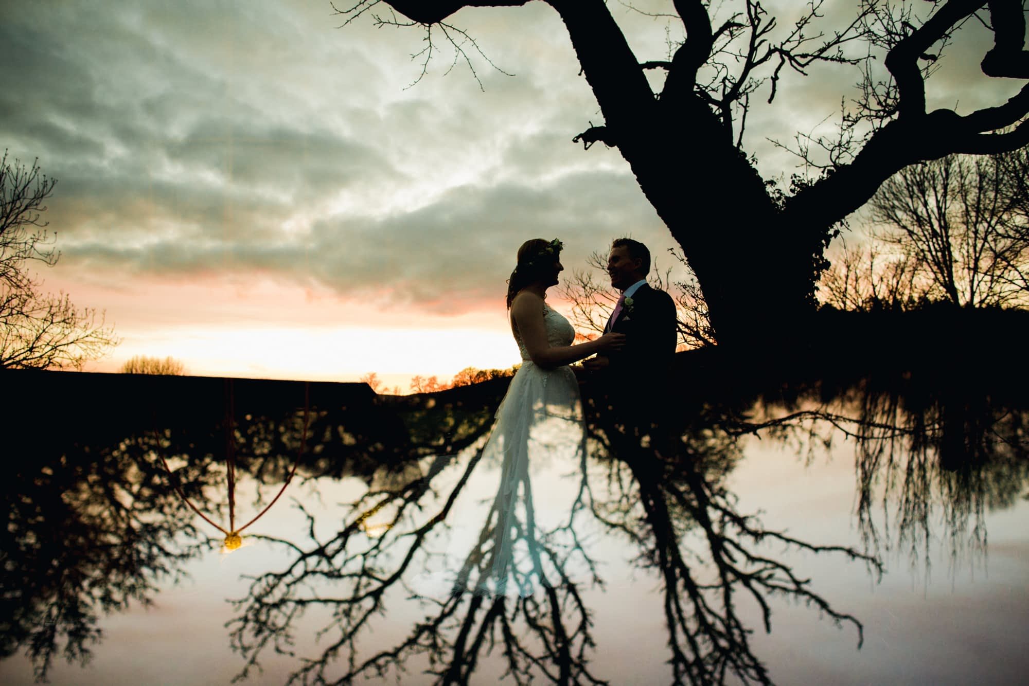 couple in portraits with tree
