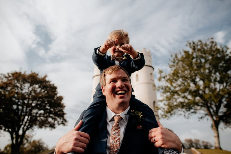 boy on dads shoulders at haldon tower